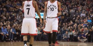 Feb 12, 2017; Toronto, Ontario, CAN; Toronto Raptors guard Kyle Lowry (7) and Toronto Raptors guard DeMar DeRozan (10) react during a break in the first quarter in a game against the Detroit Pistons at Air Canada Centre.The Detroit Pistons won 102-101. Mandatory Credit: Nick Turchiaro-USA TODAY Sports
