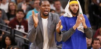 Mar 29, 2017; San Antonio, TX, USA; Golden State Warriors small forward Kevin Durant (left) and JaVale McGee (1) cheer from the bench after a score against the San Antonio Spurs during the first half at AT&T Center. Mandatory Credit: Soobum Im-USA TODAY Sports