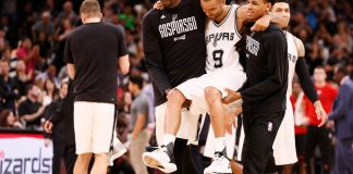 May 3, 2017; San Antonio, TX, USA; San Antonio Spurs point guard Tony Parker (9) is helped off the court after being injured against the Houston Rockets during the second half in game two of the second round of the 2017 NBA Playoffs at AT&T Center. Mandatory Credit: Soobum Im-USA TODAY Sports