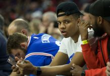 Apr 4, 2017; Philadelphia, PA, USA; NBA draft prospect Markelle Fultz watches court side during the second half of a game between the Philadelphia 76ers and the Brooklyn Nets at Wells Fargo Center. The Brooklyn Nets won 141-118. Mandatory Credit: Bill Streicher-USA TODAY Sports