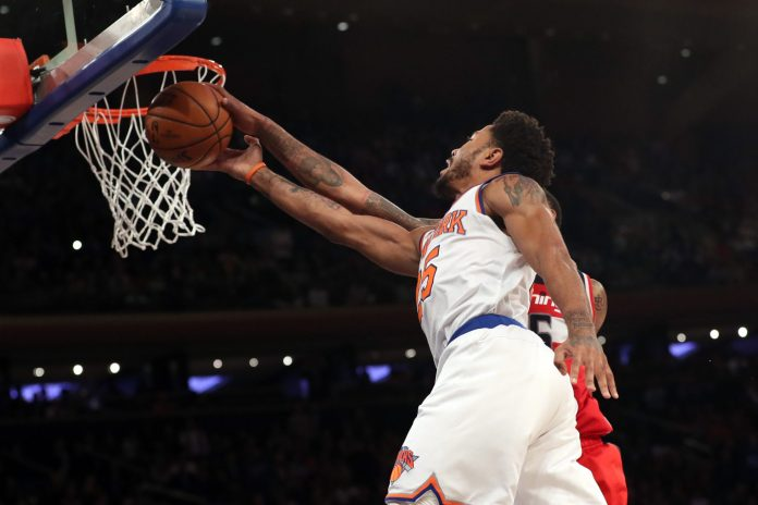Jan 19, 2017; New York, NY, USA;  Washington Wizards forward Markieff Morris (5) keeps New York Knicks guard Derrick Rose (25) from a shot during the fourth quarter at Madison Square Garden. Washington Wizards won 113-110. Mandatory Credit: Anthony Gruppuso-USA TODAY Sports