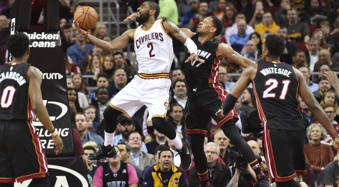 Mar 6, 2017; Cleveland, OH, USA; Cleveland Cavaliers guard Kyrie Irving (2) drives to the basket against Miami Heat guard Rodney McGruder (17) during the first half at Quicken Loans Arena. Mandatory Credit: Ken Blaze-USA TODAY Sports