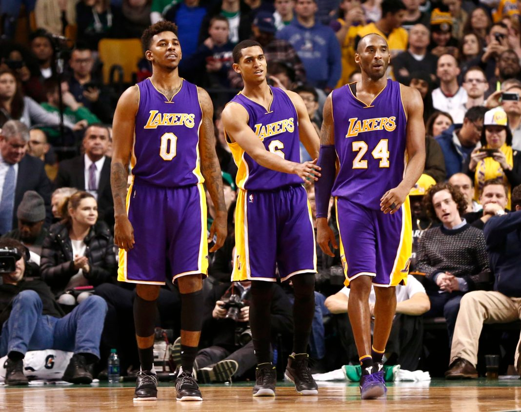 Dec 30, 2015; Boston, MA, USA; Los Angeles Lakers forward Kobe Bryant (24) celebrates with guard Jordan Clarkson (6) and forward Nick Young (0) during the second half of a game against the Boston Celtics at TD Garden. Mandatory Credit: Mark L. Baer-USA TODAY Sports