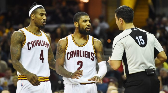 Dec 23, 2016; Cleveland, OH, USA; Cleveland Cavaliers guard Iman Shumpert (4) and guard Kyrie Irving (2) argue with referee Zach Zarba (15) during the first half against the Brooklyn Nets at Quicken Loans Arena. Mandatory Credit: Ken Blaze-USA TODAY Sports