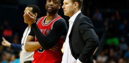 Mar 13, 2017; Charlotte, NC, USA; Chicago Bulls guard Dwyane Wade (3) talks with head coach Fred Hoiberg (R) during the second half against the Charlotte Hornets at Spectrum Center. The Bulls won 115-109. Mandatory Credit: Jeremy Brevard-USA TODAY Sports