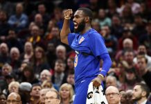 Oct 29, 2017; Cleveland, OH, USA; New York Knicks guard Tim Hardaway Jr. (3) celebrates a basket on the bench during the first half against the Cleveland Cavaliers at Quicken Loans Arena. Mandatory Credit: Ken Blaze-USA TODAY Sports