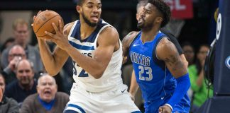 Nov 4, 2017; Minneapolis, MN, USA; Minnesota Timberwolves center Karl-Anthony Towns (32) backs towards the basket against defense from Dallas Mavericks guard Wesley Matthews (23) in the first half at Target Center. Mandatory Credit: Jesse Johnson-USA TODAY Sports