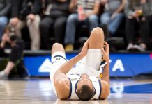 Nov 10, 2017; Salt Lake City, UT, USA; Utah Jazz center Rudy Gobert (27) lies on the court after injuring his knee during the second half against the Miami Heat at Vivint Smart Home Arena. Mandatory Credit: Russ Isabella-USA TODAY Sports