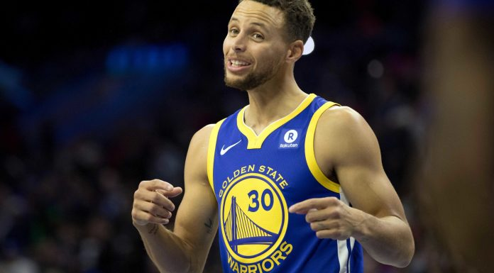 Nov 18, 2017; Philadelphia, PA, USA; Golden State Warriors guard Stephen Curry (30) reacts in the direction of the Philadelphia 76ers bench during the first quarter at Wells Fargo Center. Mandatory Credit: Bill Streicher-USA TODAY Sports