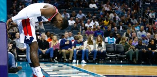 Nov 22, 2017; Charlotte, NC, USA; Washington Wizards guard John Wall (2) leans against the stanchion in the second half against the Charlotte Hornets at Spectrum Center. Mandatory Credit: Jeremy Brevard-USA TODAY Sports