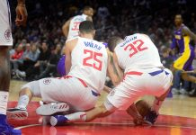 November 27, 2017; Los Angeles, CA, USA; Los Angeles Clippers guard Austin Rivers (25) collides with forward Blake Griffin (32) while playing for the ball against the Los Angeles Lakers during the second half at Staples Center. Griffin would later leave the game with an apparent injury. Mandatory Credit: Gary A. Vasquez-USA TODAY Sports