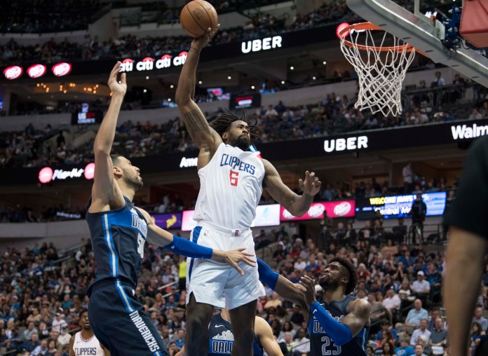 Dec 2, 2017; Dallas, TX, USA; LA Clippers center DeAndre Jordan (6) dunks the ball against Dallas Mavericks center Salah Mejri (50) and guard Wesley Matthews (23) during the second half at the American Airlines Center. The Mavericks defeat the Clippers 108-82. Mandatory Credit: Jerome Miron-USA TODAY Sports