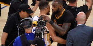 Jun 12, 2017; Oakland, CA, USA; Golden State Warriors guard Stephen Curry (30) hugs Cleveland Cavaliers forward LeBron James (23) after game five of the 2017 NBA Finals at Oracle Arena. Mandatory Credit: Kyle Terada-USA TODAY Sports