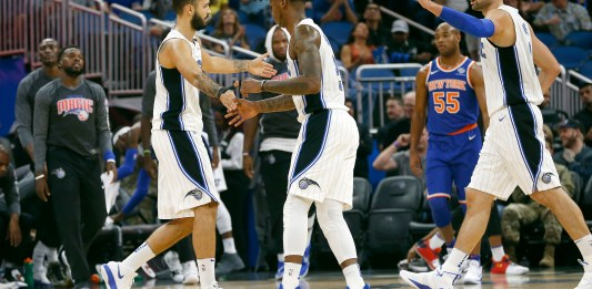 Nov 8, 2017; Orlando, FL, USA; Orlando Magic forward Evan Fournier (left) is congratulated by guard Elfrid Payton (middle) and center Nikola Vucevic (right) after making a three pointer against the New York Knicks during the first quarter at Amway Center. Mandatory Credit: Kim Klement-USA TODAY Sports