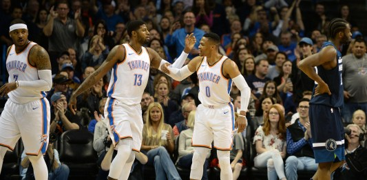 Dec 1, 2017; Oklahoma City, OK, USA; Oklahoma City Thunder forward Carmelo Anthony (7) forward Paul George (13) and guard Russell Westbrook (0) react after a play against the Minnesota Timberwolves at Chesapeake Energy Arena. Mandatory Credit: Mark D. Smith-USA TODAY Sports