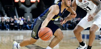 Jan 3, 2018; Providence, RI, USA; Marquette Golden Eagles guard Markus Howard (0) drives to the basket in front of Providence Friars guard Jalen Lindsey (21) during the first half at the Dunkin Donuts Center. Mandatory Credit: Brian Fluharty-USA TODAY Sports