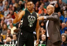 Apr 8, 2016; Boston, MA, USA; Milwaukee Bucks head coach Jason Kidd (right) speaks to forward Jabari Parker (12) during the first half of a game against the Boston Celtics at TD Garden. Mandatory Credit: Mark L. Baer-USA TODAY Sports