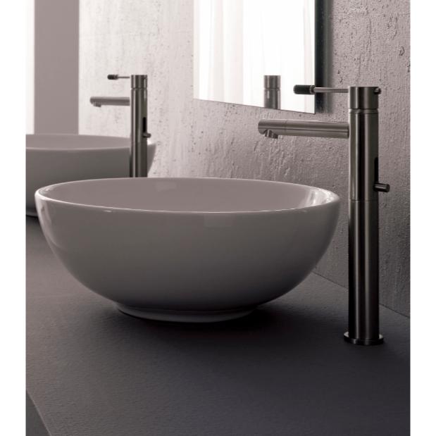 round white ceramic vessel sink