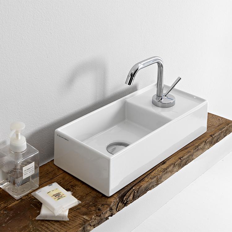 rectangular small white ceramic vessel sink