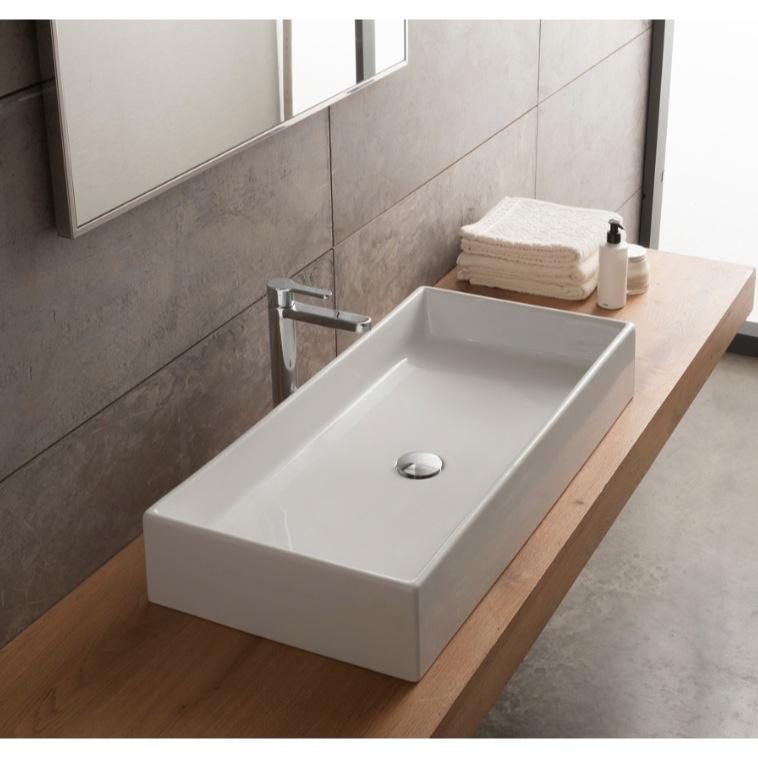 rectangular white ceramic vessel sink