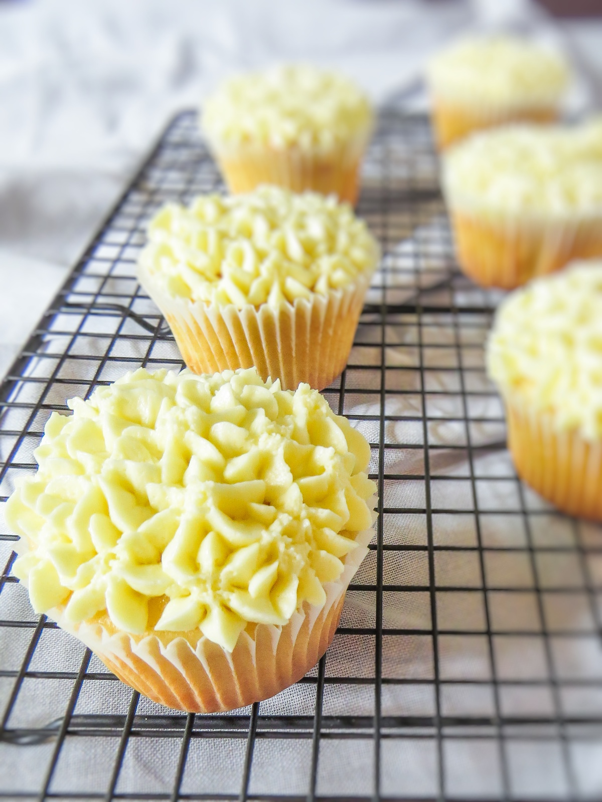 Hydrangea in Bloom Cupcakes - Simple vanilla buttermilk cupcakes topped are made stunning with with yummy lemon buttercream pipped as hydrangeas. Perfect for a special occasion, like your flower loving mom's birthday, or just because!