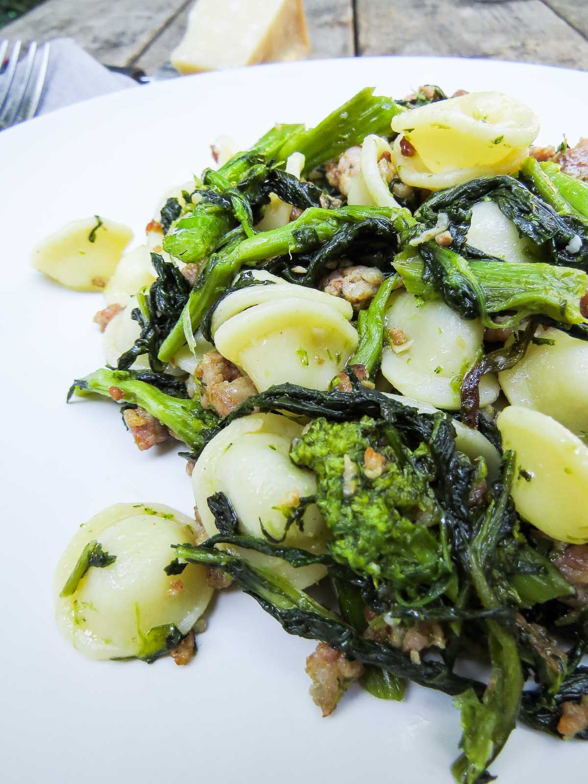 Orecchiette with Rapini & Sausage - Delicious juicy Italian sausage and the slightly bitter yummy taste of rapini come together again to make an awesome traditional pasta dish. It's great for supper tonight and lunch tomorrow; cold or hot!
