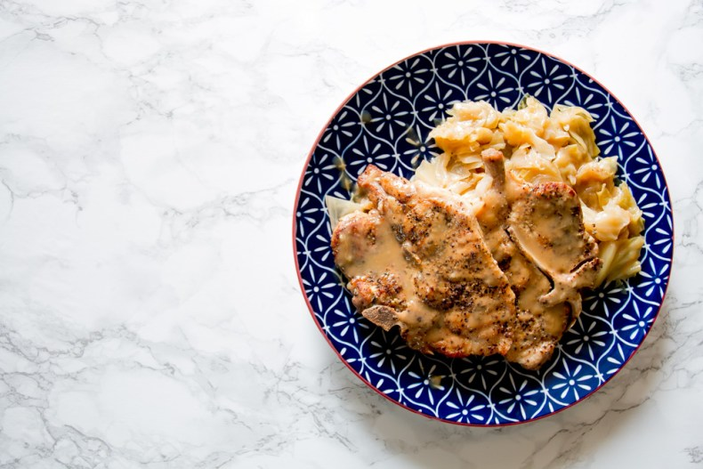 Super tender delicious pork chops and cabbage in the pressure cooker. It's low carb and no fuss. There are minimal ingredients but the taste is sophisticated.