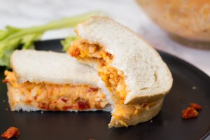 Smoky Pimiento Cheese - Not your everyday pimiento cheese. Nope. We used smoked cheeses, a dash of chipotle powder, and sun dried tomatoes for extra smokey goodness!
