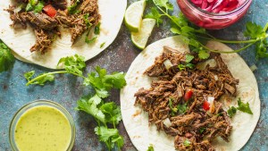 Flavor Bomb Barbacoa - Tender, shredded beef cooked in a flavor bomb sauce. In the Instant Pot, or any pressure cooker, you can have barbacoa any time you want!