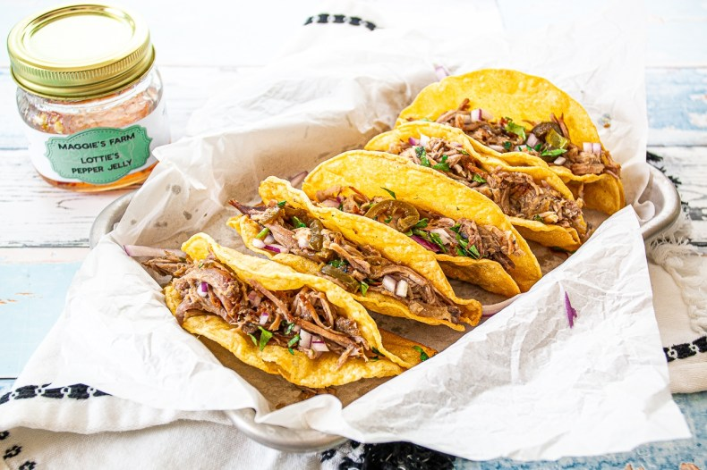 These crazy delicious pork tacos are made in your slow cooker will keep you coming back for more!