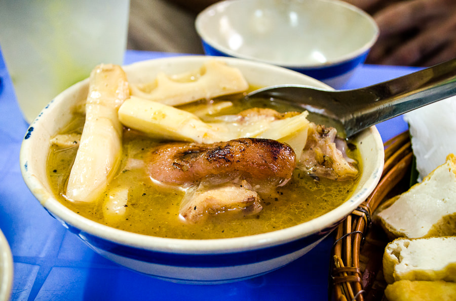 A steaming hot bowl of Gia Cay, dog soup in Saigon, Vietnam.