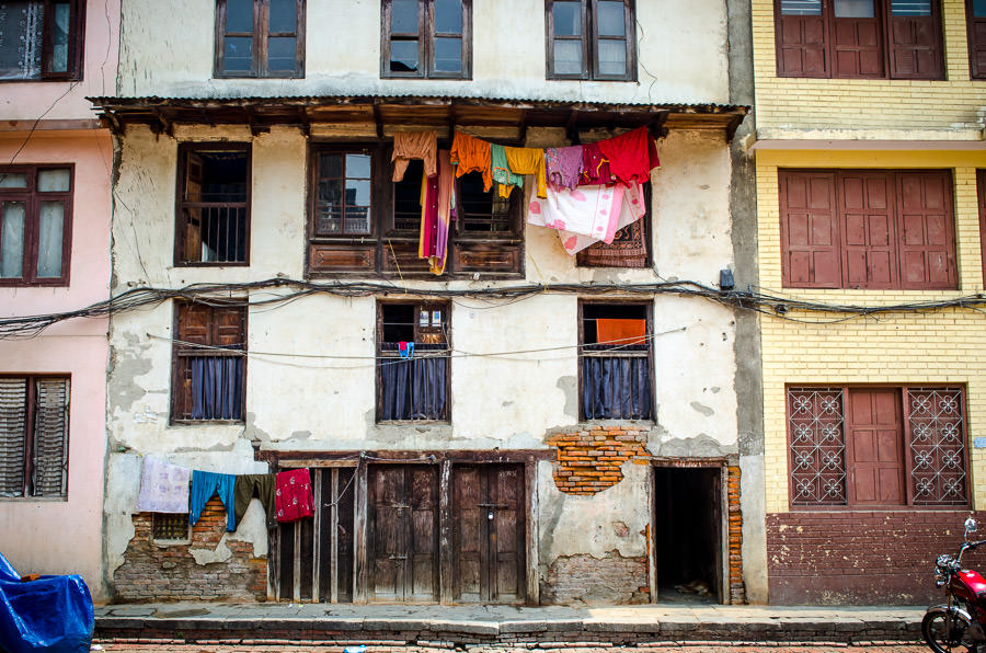 Colorful clothes hanging on a clothesline.