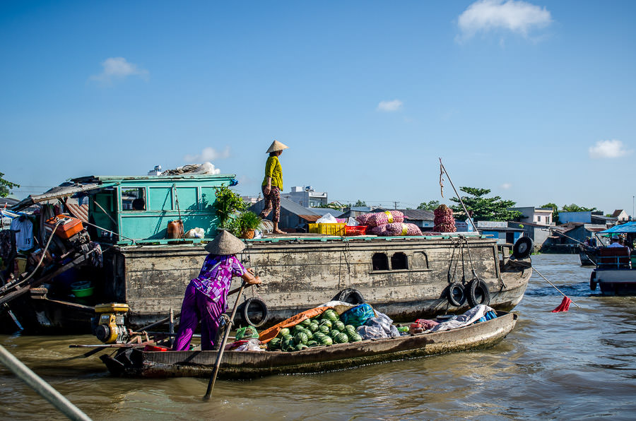 Woman doing business at the floating market in Can Tho, Vietnam.