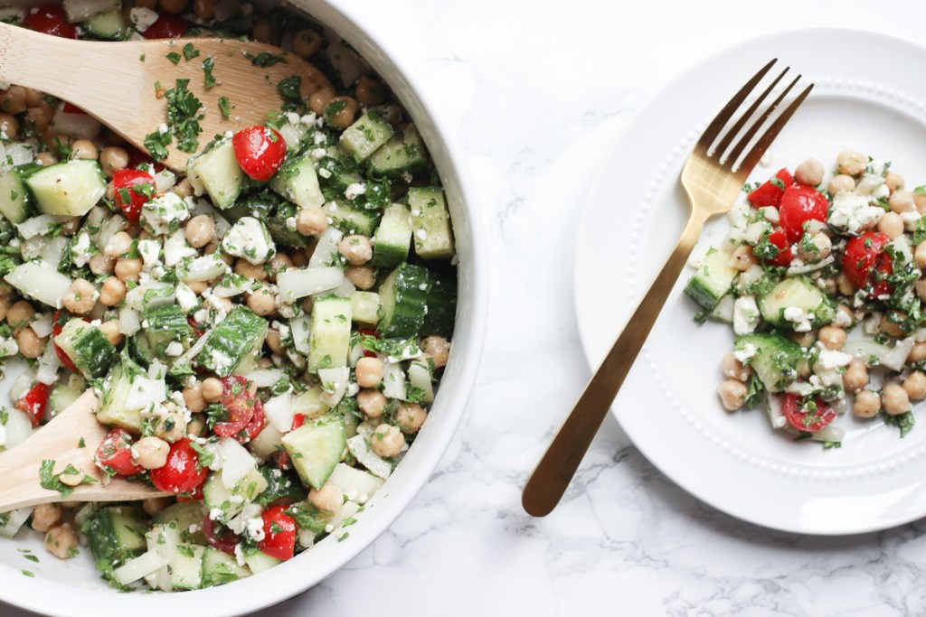THE PERFECT SUMMER SALAD | This delicious chickpea summer salad combines chickpeas, cucumber, onion, tomatoes and feta with a oil, vinegar and cumin dressing for a flavorful summer salad that is sure to please any crowd. Perfect for a hot summer night, when you don't want to cook, or a great picnic salad for a crowd | CHICKPEA SALAD | SUMMER SALAD | PICNIC SALAD | GREEK CHICKPEA SALAD | FRESH VEGETABLES | PARSLEY | SUMMER SALAD RECIPE | FETA | MAKE AHEAD | FOR A CROWD | COLD | WITH CHICKEN | VEGETARIAN | LOW CARB | FOR PARTIES | BEST | #summersalad #lowcarb #plantbased #vegetarian