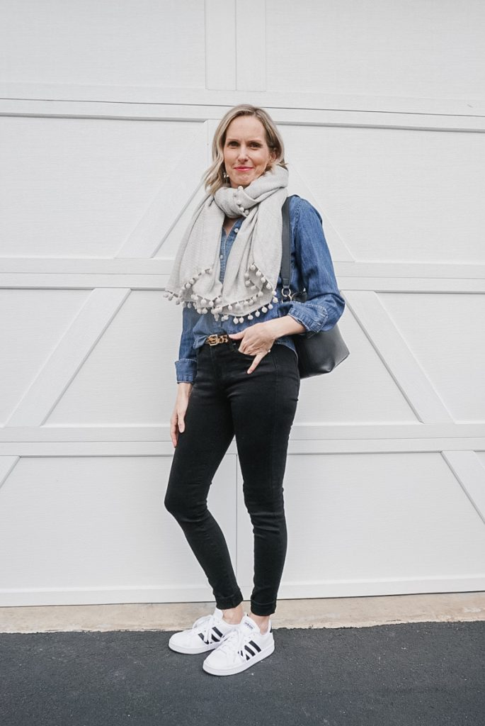 MY FAVORITE SPRING TRANSITION OUTFIT | I am sharing my favorite spring transition outfit, including a cute pom pom scarf for those chilly mornings, the perfect pair of black jeans, my staple denim shirt and a cute pair of sneakers. #springoutfits #over40 #dailystyle #denimondenim #casualoutfit #momstyle