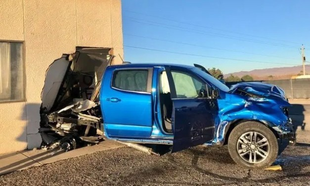 Truck smashes through business