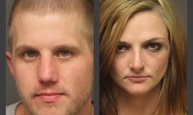 Hand Gun, Heroin, Meth and an active arrest warrant.