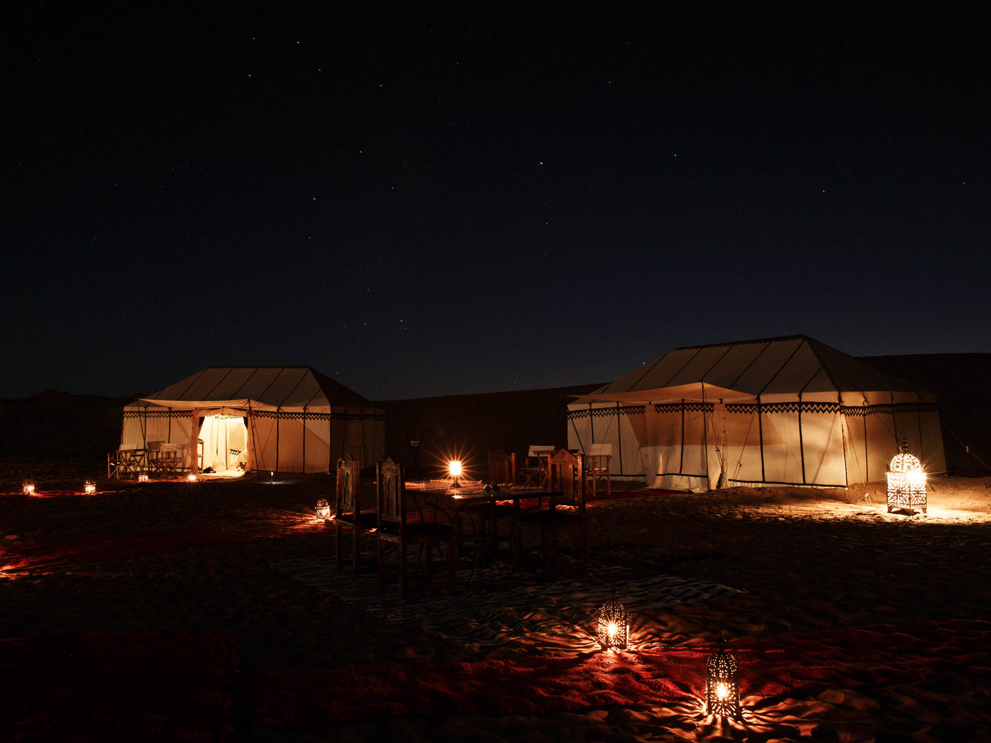 Candle Light at Nubia Luxury Desert Camp Morocco Under Clear Starlight Sky
