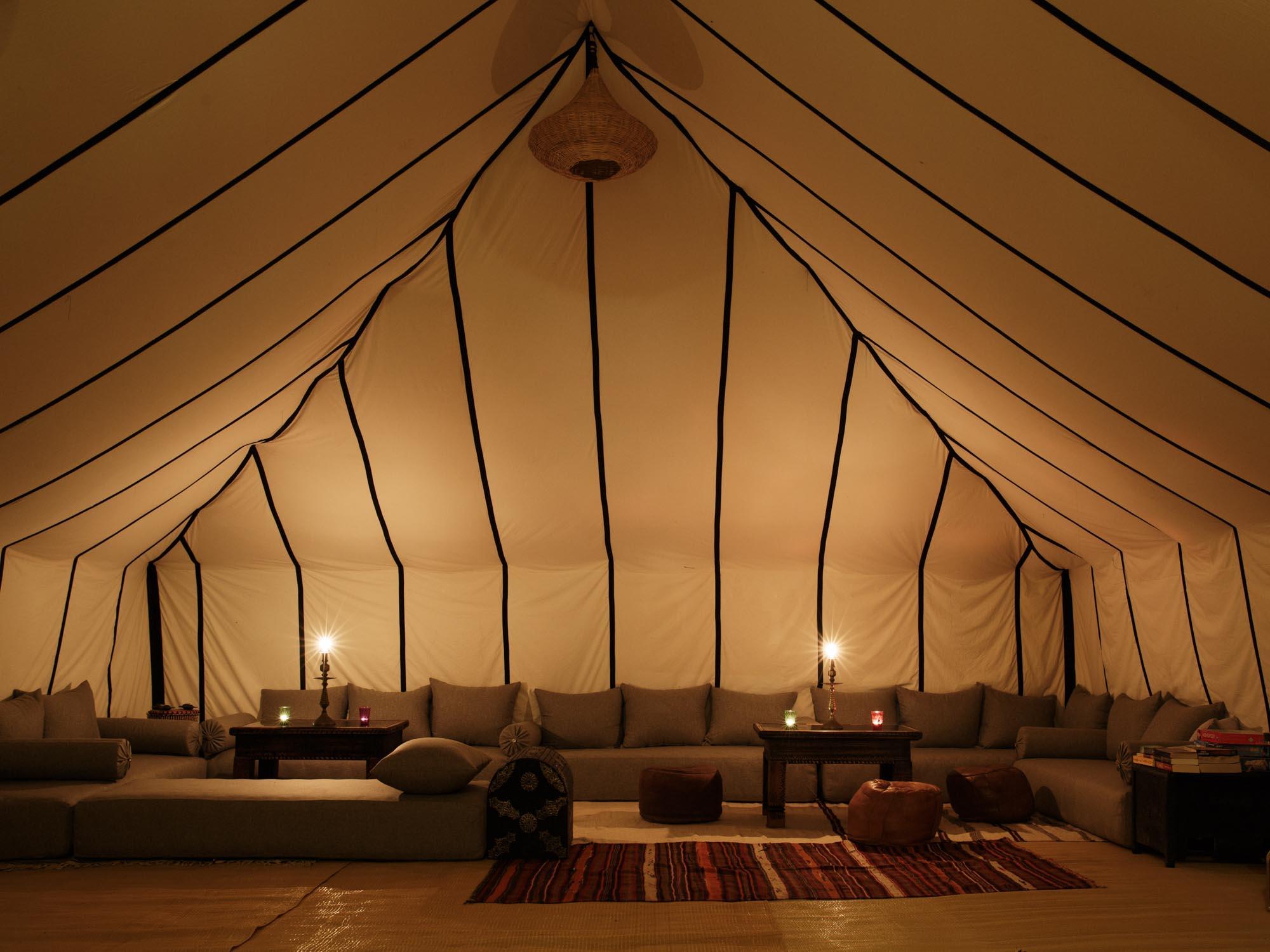 Evening inside the luxury desert camp Morocco lounge