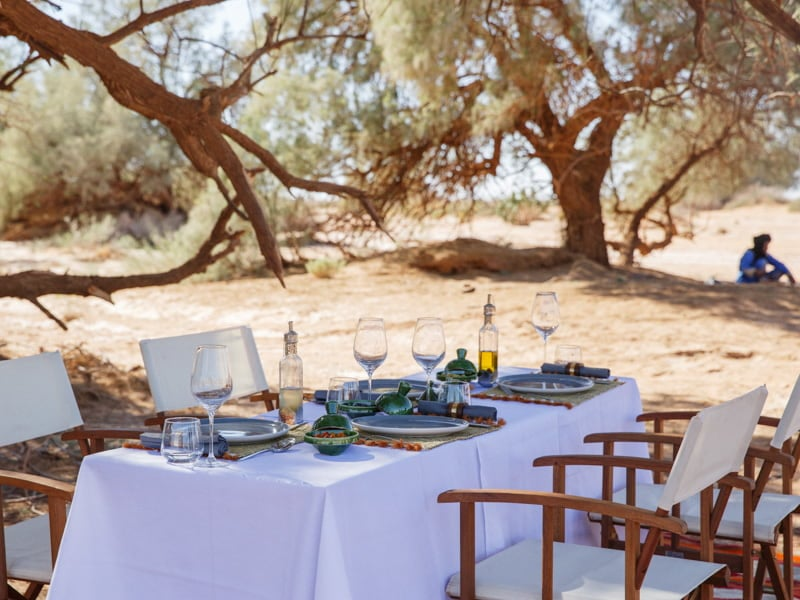 Desert Camp Dining Table with Authentic Traditional Picnic Lunch