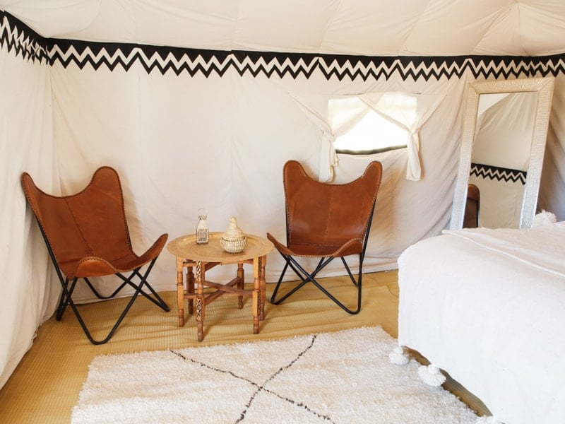 Occasional Table and Chairs at Luxury Desert Camp Bedroom