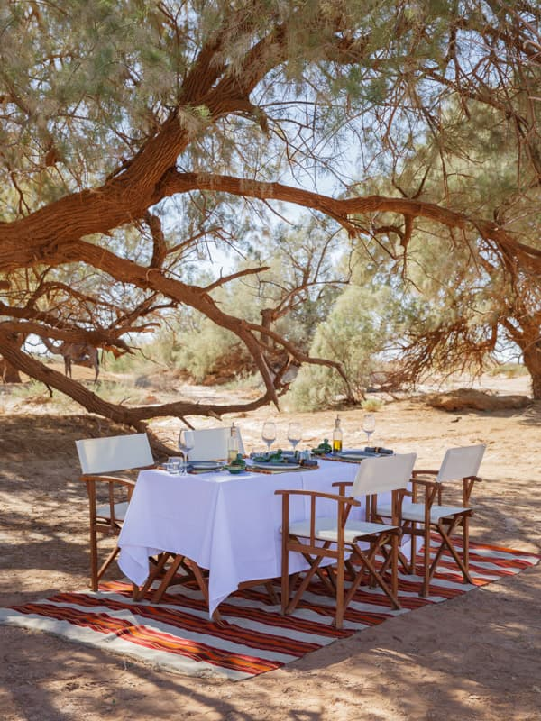 Dining Table Under the Shade at Private Moroccan Desert Camp