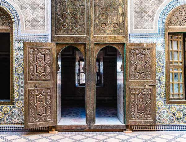 Decorative Facade and Carved Wooden Door Panels on Moroccan Building