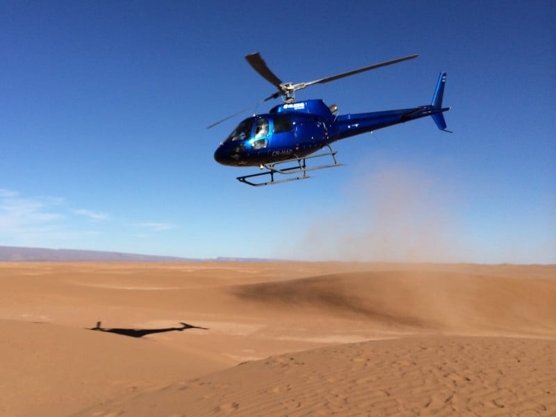 Morocco Tour Helicopter flying over desert sand dunes