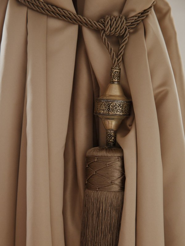 Handmade Moroccan curtain ties: detailed brass ornament, silk tassels and thick robe ties.