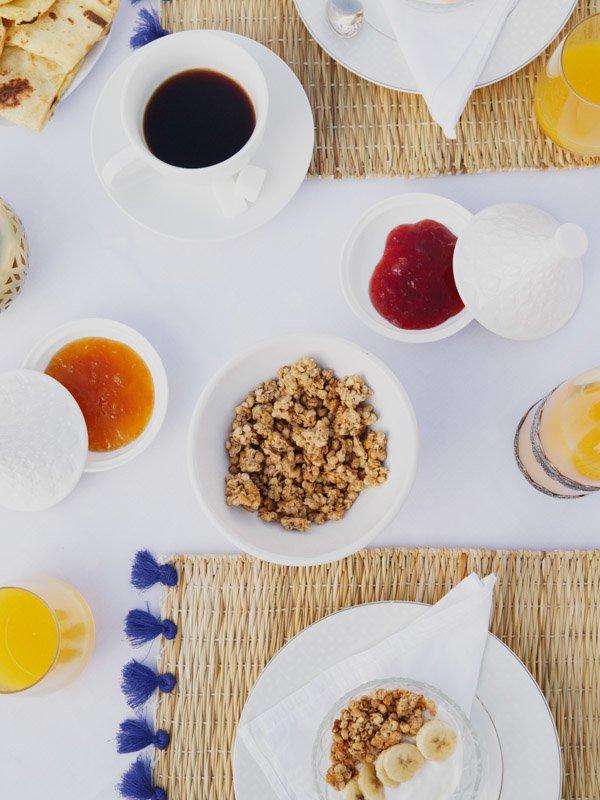 Breakfast Dish of Granola with Sliced Banana, Cup of Coffee, Fresh Orange