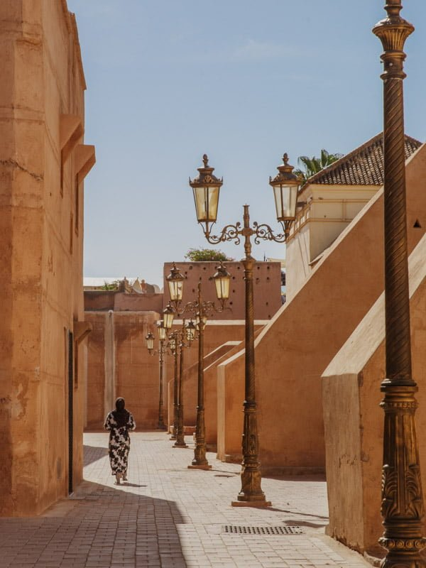 Decorative carved street lanterns and old walls in Moroccan back street