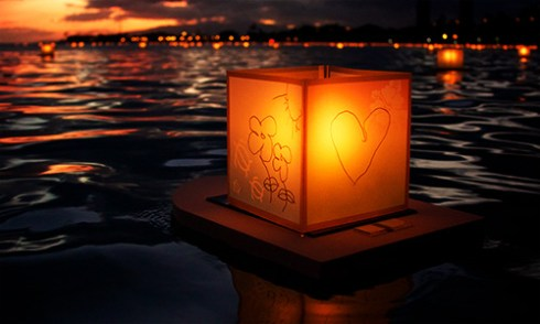 how to be present in the now - square paper lantern floating on water at night