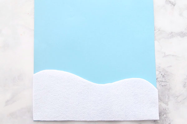 Add White Felt Snow for Penguin Craft