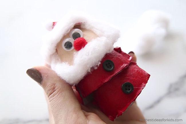 Glue Buttons on Egg Carton Santa
